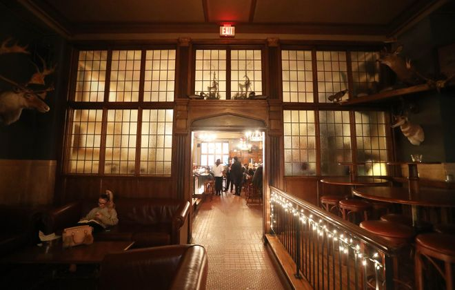 One of the Hotel @ the Lafayette's businesses, The Lafayette Brewing Company, is filled with the feeling of the Teddy Roosevelt era. Much of the space has been restored. (Sharon Cantillon/Buffalo News)