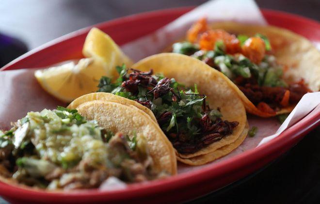 Three taco order from Mexico City in Hamburg. Tacos, from left, are pork barbacoa with cactus, chapulin and al pastor. (Sharon Cantillon/Buffalo News)