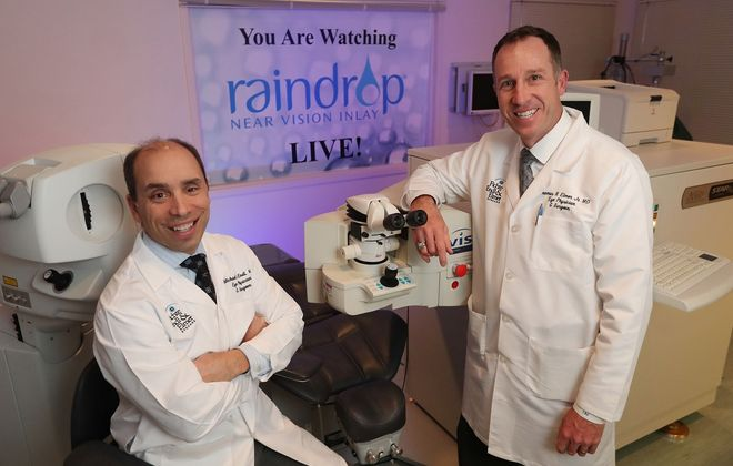 Drs. Micheal Endl, left, and Thomas Elmer, partners and ophthalmologists at Fichte, Endl & Elmer Eyecare in Amherst and the Town of Niagara, were the first to bring the Raindrop Near Vision Inlay to Western New York.  The tiny inlay enables those with good distance vision to see better up close. (Sharon Cantillon/Buffalo News)