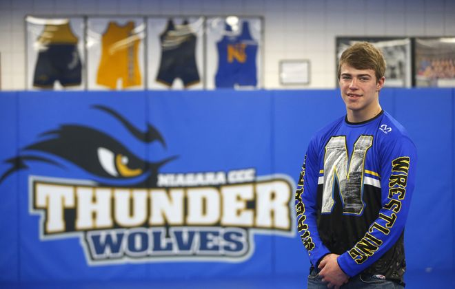 Troy Keller will leave a legacy on the walls of the NCCC wrestling room. (Mark Mulville/Buffalo News)