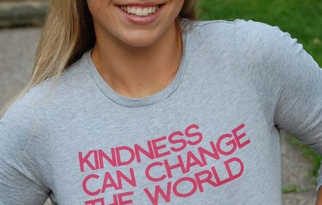 """Natalie Lewis, who went to St. Rose of Lima School and Nardin Academy, was 24 when she was killed in a hot air balloon in Virginia. Here, she is wearing one of her favorite shirts with the phrase """"Kindness can change the world,"""" according to her mother, Trish Lewis. (Provided by Trish Lewis)"""