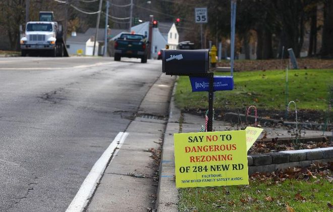 Anti-development signs once dotted lawns near 284 New Road, where Angelo Natale plans to construct 84 homes. He closed on his $1.1 million purchase of the 57-acre site this week. (John Hickey/Buffalo News file photo)