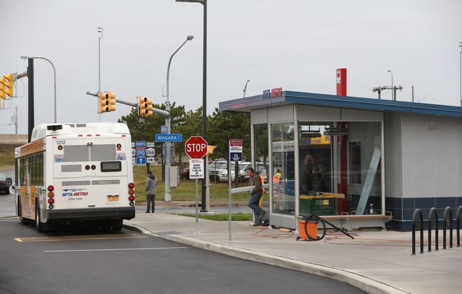 The new Metro Bus hub is in operation at Niagara St. at Ontario St. in Buffalo, Monday, Dec. 21, 2015. Telco Construction is finishing the bus shelter today which has an electronic sign displaying the bus schedule and arrivals. (Sharon Cantillon/Buffalo News)