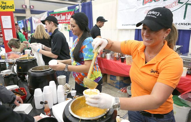 Melinda Ebeling, right, and Melissa Schaumloeffel of Danny's are pictured dishing out soup at Soup-Fest in 2014. The event returns for another year.  (Robert Kirkham/Buffalo News)