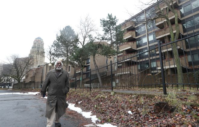 Stephen Williams is a former tenant of the Shoreline Apartments on Niagara Street who recently moved out. Williams, who lived there for 20 years, walks in front of the apartments on Tuesday, Jan. 23, 2018. (Sharon Cantillon/Buffalo News)