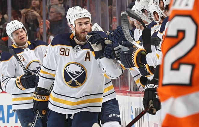 Teammates give it up to Ryan O'Reilly after he scored the Sabres' only goal Sunday in Philadelphia at 1:50 of the second period. (Getty Images)