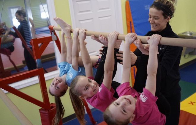 """""""Whenever the kids were my patients, it was the best part of my day,"""" says Rachel Daving, a former dental hygienist and owner of The Little Gym of Williamsville, with, from left, the three Kagels sisters, Audriana, 6, Alexis 8, and Abigail,  4. (Derek Gee/Buffalo News)"""