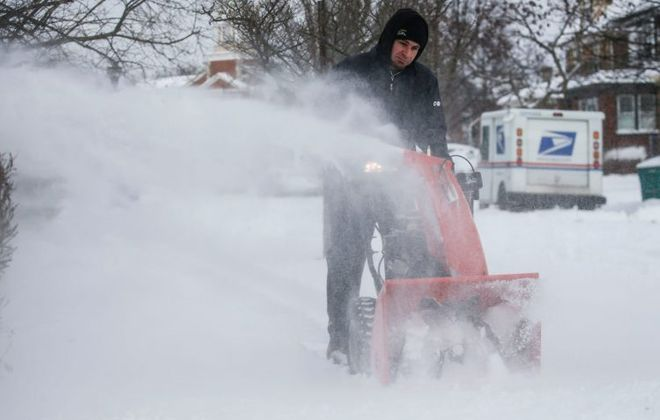 Snowblowers will be churning again. Another fresh coating of lake-effect snow is forecast today over metro Buffalo. (Derek Gee/Buffalo News)