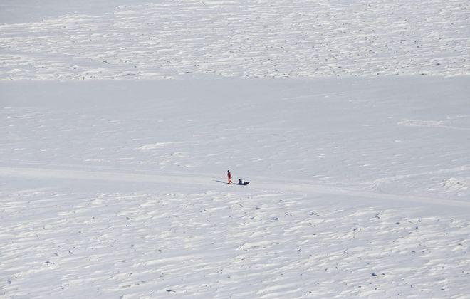 An ice fisherman at Sturgeon Point Marina. (Derek Gee/News file photo)