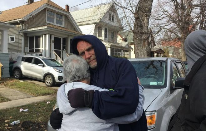 "A neighbor comforts Joe Conti, whose 7-year-old son, Anthony, died in a fire in Lovejoy this morning. ""I failed him,"" he said crying. (Maki Becker/Buffalo News)"