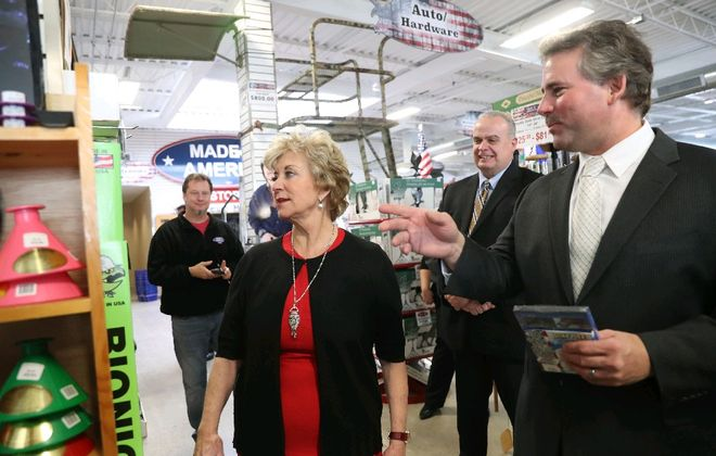SBA Administrator Linda McMahon tours the Made in America store in Elma with owner Mark Andol. (Sharon Cantillon/Buffalo News)