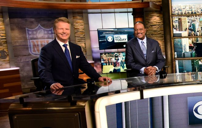"Phil Simms, left, with James Brown on the set of CBS's ""The NFL Today."""