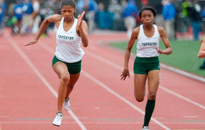 Nia Stevens, left, and Taylor Hunter from Tapestry Charter compete in the 100 meters during the 2016 NYSPHSAA Track & Field Championships. (Harry Scull Jr./Buffalo News)