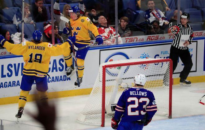 Alexander Nylander congratulates Oskar Steen on his goal as Sweden knocked off the U.S. in the World Junior semifinals. (Harry Scull, Jr./Buffalo News)