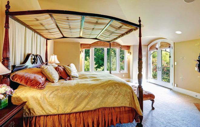 Canopy beds create a more intimate sleeping space, especially in today's larger master bedrooms.