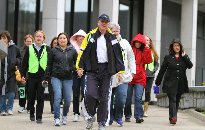 Phil Haberstro, center, executive director of the Wellness Institute of Greater Buffalo, has announced that Rod Nagy has become the institute's newest walkability advocate. (Mark Mulville/News file photo)
