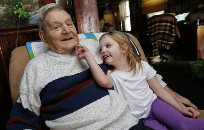 John Phillips, one of the last orphans from Lackawanna who actually met Monsignor Nelson Baker, with his great-granddaughter, Allie Prusinski, 5. (Robert Kirkham/The Buffalo News)
