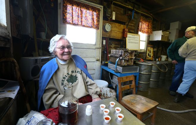 """In 2015, Florence Merle - then """"only"""" 100 - poured shots of maple syrup for visitors to the Merle Maple Farm in Attica. (Mark Mulville/The Buffalo News)"""