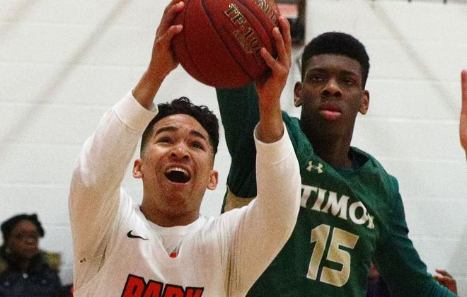 Park's Noah Hutchins scores two points over Timon-St. Jude's Master Radford during Friday night's clash at The Park School.  (James P. McCoy / Buffalo News)