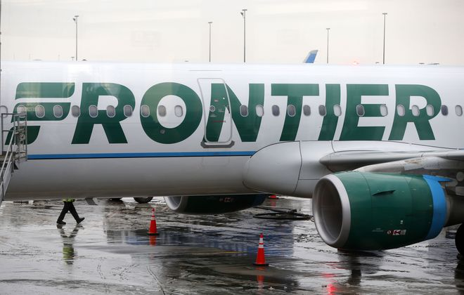 A Frontier Airlines plane gets ready to board passengers on a flight to Ft. Myers, Fla., at the Buffalo and Niagara International Airport in Cheektowaga.   (Mark Mulville/Buffalo News)