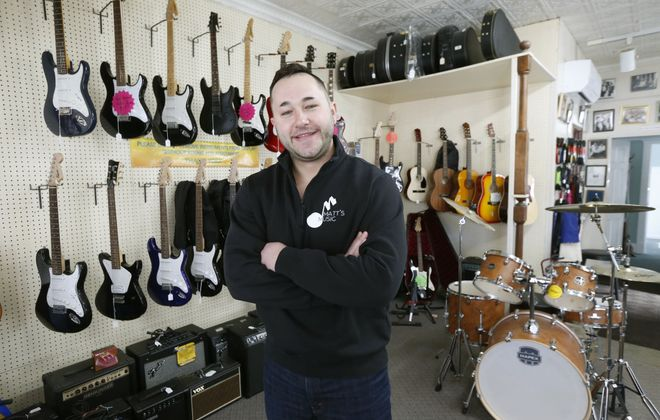 Zach Carr is a third generation family member who works at Matt's Music in North Tonawanda. (Robert Kirkham/Buffalo News)