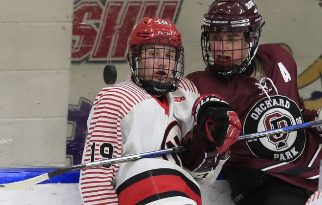 Niagara Wheatfield's Zack Belter and Orchard Park's Coleman Jacobs keep an eye on the puck during the third period of the Falcons' 3-0 win over the Quakers in the Section VI Division I semifinals. (Harry Scull Jr./Buffalo News)