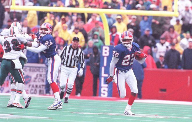 Former Bills cornerback Jeff Burris runs with the ball after intercepting Miami quarterback Craig Erickson to seal a 9-6 victory over the Dolphins on Nov. 2, 1997. (James P. McCoy/Buffalo News file photo)