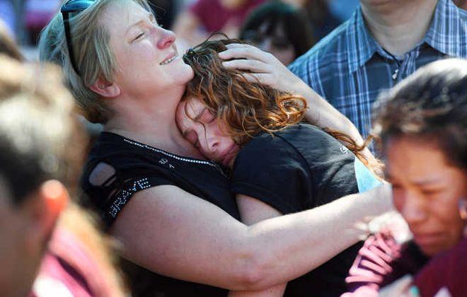 Tonya Kramer embraces her daughter Alyssa Kramer, 16, during a prayer vigil after Wednesday's school shooting in Parkland, Fla. (Matt McClain/Washington Post)