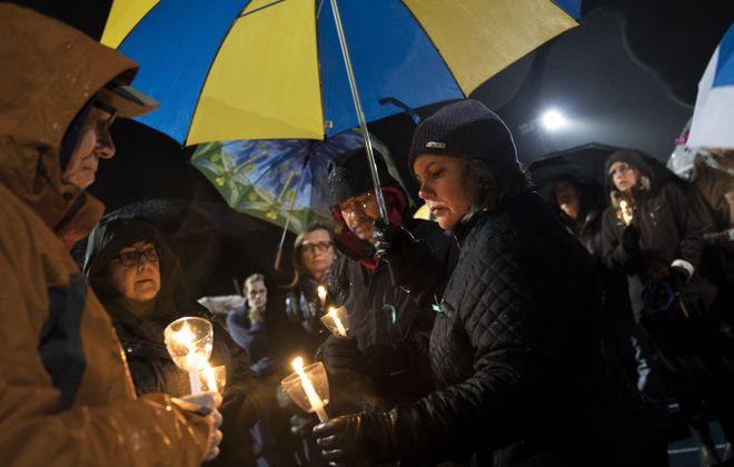 Mourners light candles at a community vigil Friday at Newtown High School in Newton, Conn., for the victims of the Feb. 14 mass shooting at Marjory Stoneman Douglas High School in Parkland, Florida. Newtown is home to Sandy Hook Elementary School, where 26 people, 20 of them children, were killed in a mass shooting in 2012. (Getty Images)