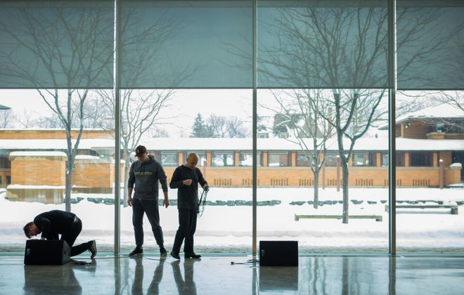 Olivier Pasquet, Creative Arts Initiative Artist in Residence at the University at Buffalo, works with an assistant in the Eleanor and Wilson Greatbatch Pavilion Visitor Center at Frank Lloyd Wright's Martin House Complex.