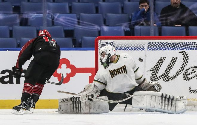 Chace Woods scores on a penalty shot for Niagara Wheatfield during its 2-0 win over Williamsville North in the Section VI Division I hockey final at KeyBank Center. (James P. McCoy/Buffalo News)