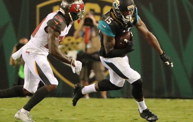 Allen Robinson of the Jacksonville Jaguars attempts to run past Ryan Smith of the Tampa Bay Buccaneers. (Getty Images)