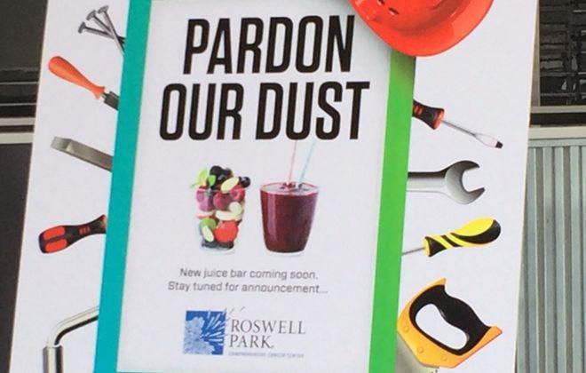A construction sign inside the Bieler Center lobby Tuesday tells of coming juice bar. (Karen Robinson/Buffalo News)