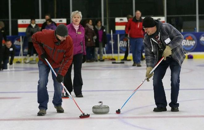 Buffalo Curling Club, which traces its roots back nearly 60 years, has gathered to play at RiverWorks since 2014. It will host an open house Saturday in its new indoor facility. (Sharon Cantillon/News file photo)