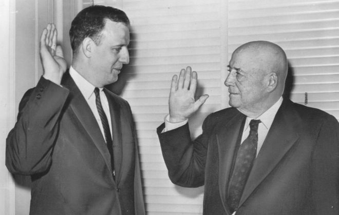 Rep. Charles E. Goodell, 33, takes the oath in 1959. He's sworn in by House Speaker Sam Rayburn after winning a special election to succeed Rep. Daniel Reed of Dunkirk. (Buffalo News file photo).