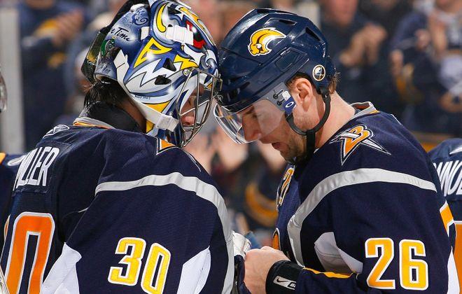 Ryan Miller and Thomas Vanek have memories that aren't as fun as postgame celebrations. (Getty Images)