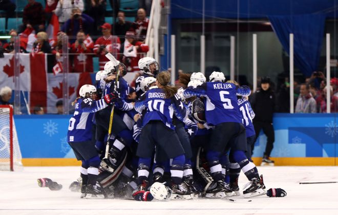 The United States celebrates after defeating Canada in a shootout to win the gold medal (Jamie Squire/Getty Images)