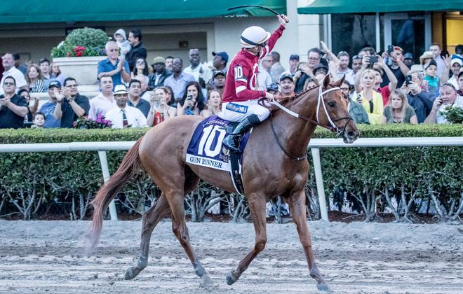 Florent Geroux waves to the Pegasus crowd after Gun Runner's win on Saturday. Photo Credit: Mason Kelley/Gulfstream