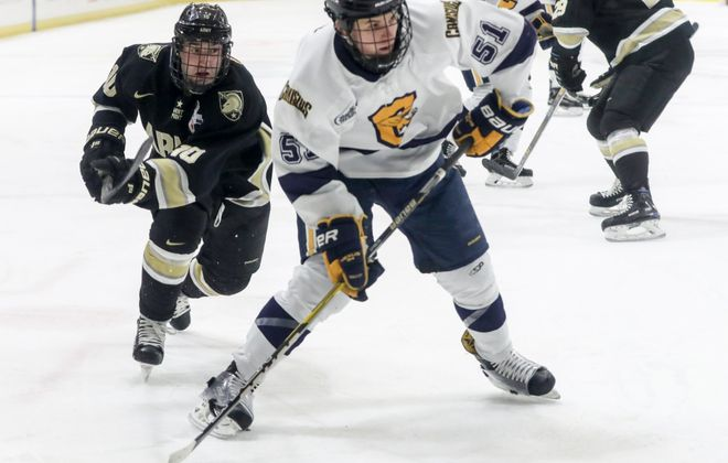 Canisius Golden Griffins forward Jeff Murray (51) beats Army West Point Black Knights forward Trevor Fidler (10) to the puck in the first period at Key Bank Center in Buffalo in N.Y. on Friday, Feb. 9, 2018. (James P. McCoy / Buffalo News)
