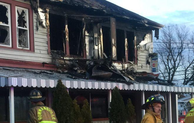 Lancaster firefighters were on the scene of a fire at 205 Central Ave. in Buffalo. (Jane Kwiatkowski/Buffalo News)