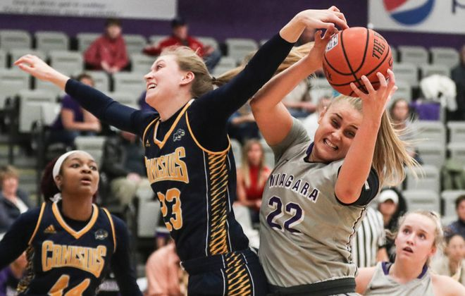 Niagara Purple Eagles forward Victoria Rampado (22) rebounds the ball away from Canisius Golden Griffins forward Sarah Cooley (23) in the first half at Gallagher CenterFeb. 20, 2018.  (James P. McCoy / Buffalo News)