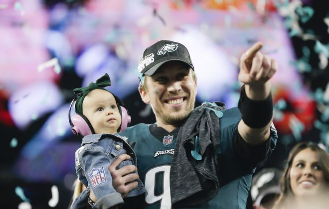 Philadelphia Eagles quarterback Nick Foles (9) with his daughter Lily James Foles after winning Super Bowl LII between the Philadelphia Eagles and New England Patriots at U.S. Bank Stadium in Minneapolis. (AJ Mast/New York Times)