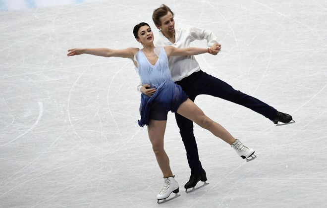 Kaitlin Hawayek and Jean-Luc Baker of the United States perform during the  free dance program at the ISU Four Continents figure skating championships in Taipei on Jan. 25, 2018.  (Anthony Wallace/AFP/Getty Images)