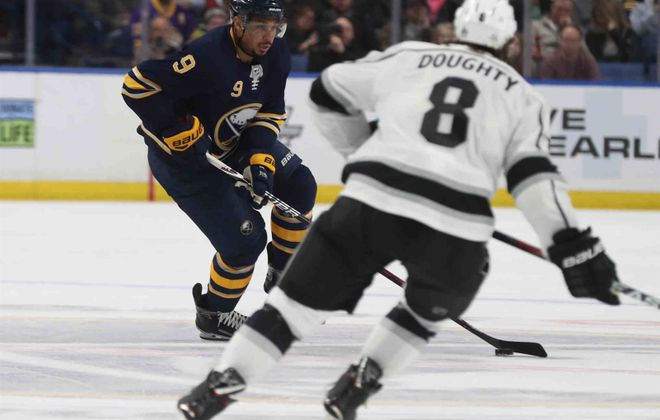 Evander Kane, who has two goals in the last 19 games, carries the puck against Los Angeles defenseman Drew Doughty (James P. McCoy/Buffalo News).