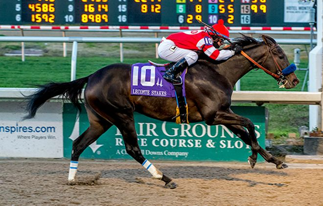 Javier Castallano pilots Instilled Regard to victory in the Lecomte Stakes at Fair Grounds.  Photo Credit: Hodges Photography / Amanda Hodges Weir