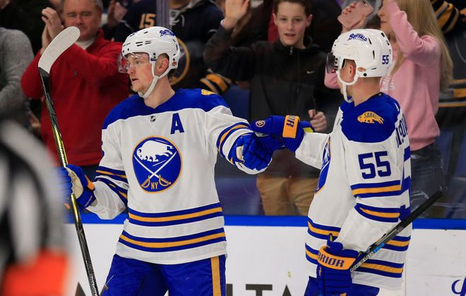 Jack Eichel celebrates his goal Thursday against the New York Islanders in KeyBank Center with Rasmus Ristolainen. Will it be his final goal of the season? (Harry Scull Jr./Buffalo News)