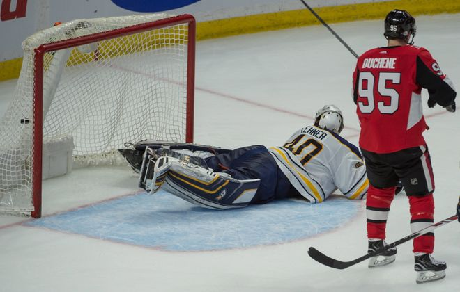 Robin Lehner sprawls in vain to stop Mike Hoffman's overtime goal as Matt Duchene gets ready to kick off the Senators' celebration (USA Today Sports).