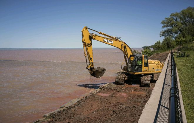 In 2017, Niagara County workers repair an access road and Olcott Beach area that were severely damaged by high water levels on Lake Ontario. (John Hickey/News file photo)