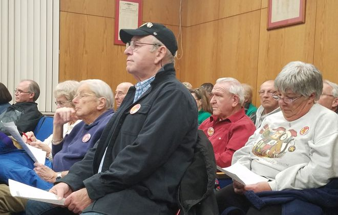 About 200 residents packed Grand Island Town Hall to hear plans for a Love's Travel Stop and Country store.