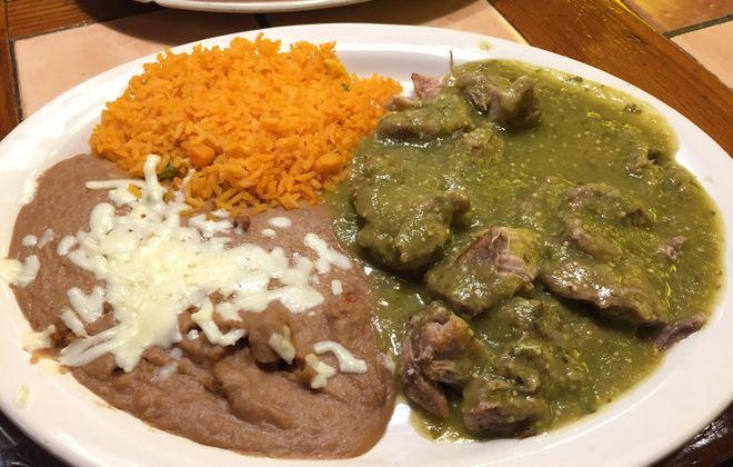 Carnitas en salsa verde ($12.99) is seasoned tender pork with hot tomatillo sauce, served with rice, beans, guacamole salad and tortillas. (Ben Tsujimoto/Buffalo News)